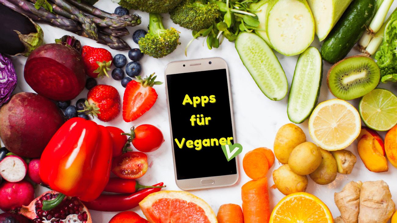 """Obst und Gemüse, in der Mitte liegt Smartphone mit Displayanzeige """"Apps für Veganer"""""""