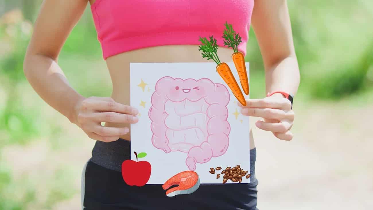 Frau mit Bild vor dem Bauch, auf dem ein Darm und Lebensmittel abgebildet sind